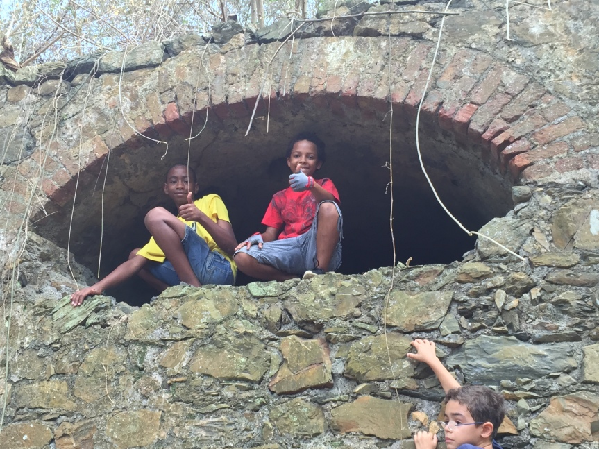 children in ruin at Mount Victory Camp