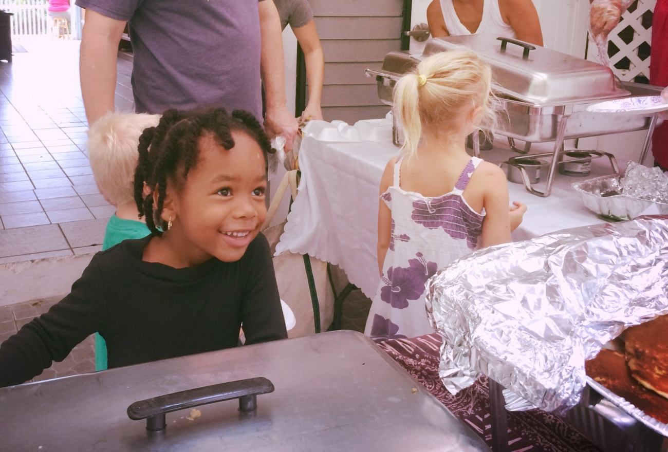 Smiling student enjoys her pancakes!
